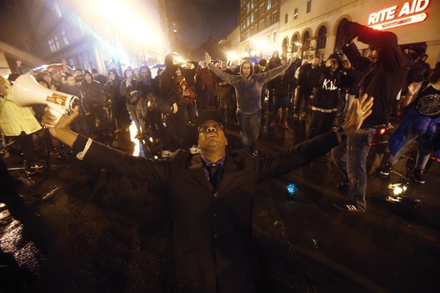 Protesters march against the New York City grand jury decision to not indict in the death of Eric Garner in Oakland, California
