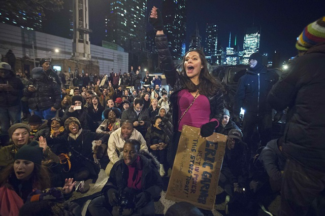 People block the Lincoln Tunnel as they protest against the grand jury decision to not indict the police officer in the death of Eric Garner, in Manhattan, New York